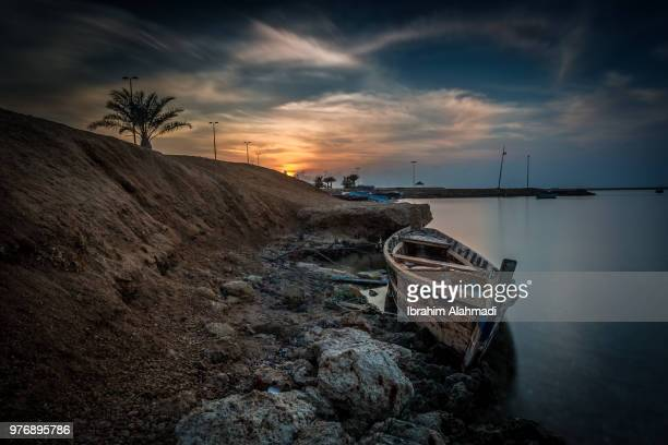old boat on shore, saudi arabia - coastline stock pictures, royalty-free photos & images