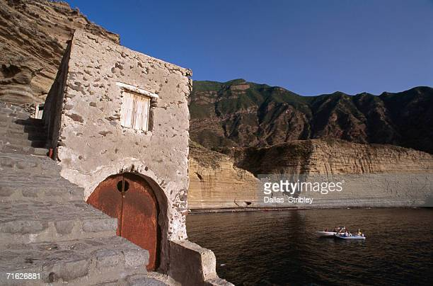 old boat shed and coastal cliffs, pollara, italy - isola di salina sicilia foto e immagini stock
