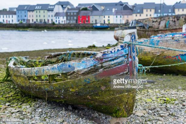 old boats near the claddagh with the long walk and old quays, ireland. - county galway stock pictures, royalty-free photos & images