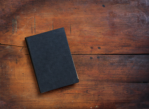 Old book on wooden background 983126938