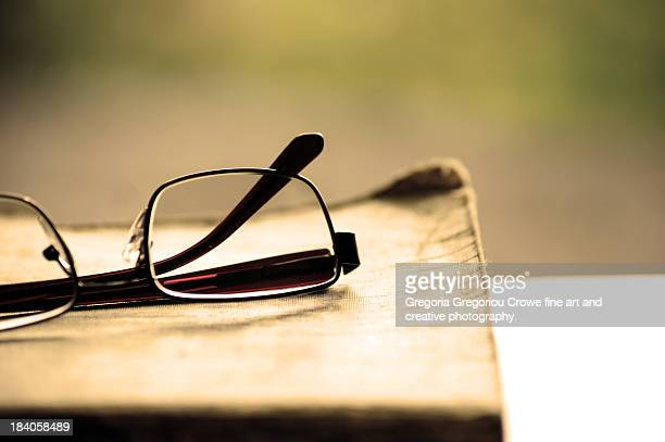 old book with reading glasses - gregoria gregoriou crowe fine art and creative photography stock photos and pictures