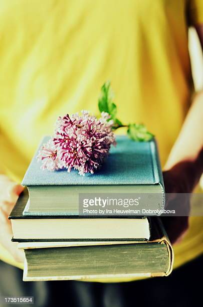 Old books and lilac branche