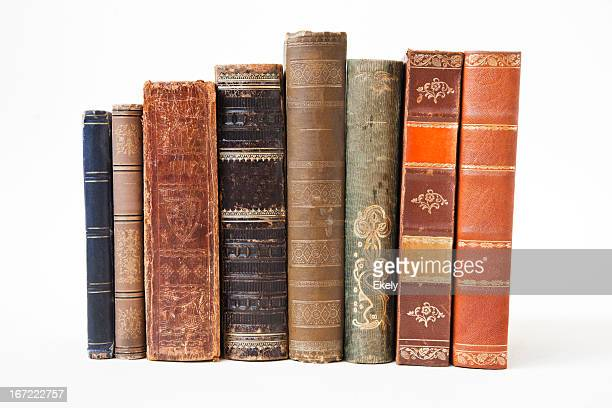 old books on white background. - antique stock pictures, royalty-free photos & images