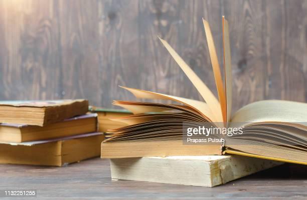 old books on wooden - enzyklopädie stock-fotos und bilder