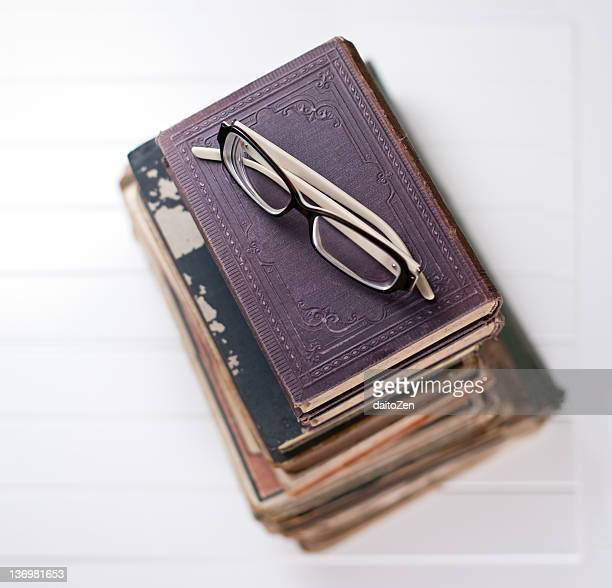 Old books with reading glasses