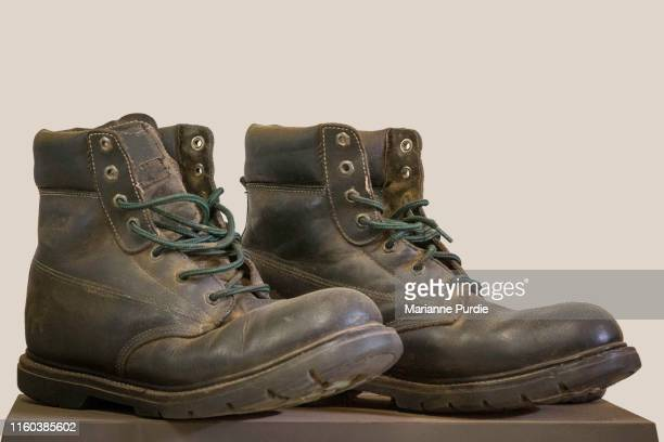 old boots - leather boot stock pictures, royalty-free photos & images