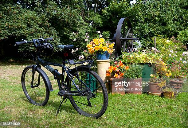 Old borehole, bicycle and English garden, Providence House, Kent, UK