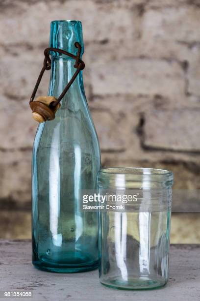 Old bottle and a glass
