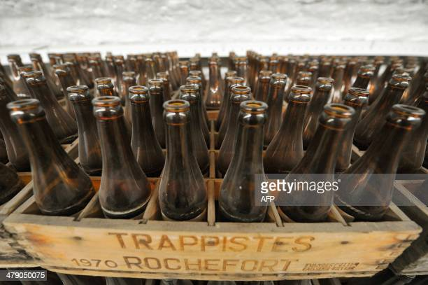 Old bottles of Trappist beers are stored in a cellar on February 19 2014 at the Rochefort Abbey Brewery southeast of Brussels Whether blonde amber or...