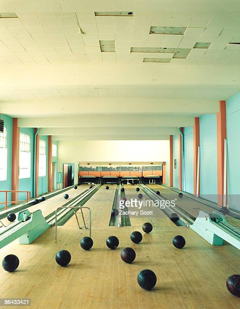 old bowling alley with rogue bowling balls - ボーリング場 ストックフォトと画像