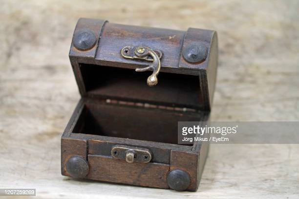old box on worden background - treasuregold stock pictures, royalty-free photos & images