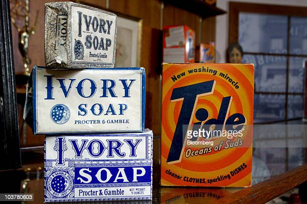 Old boxes of Tide detergent and Ivory soap are arranged for a photo in the Procter Gamble Co Archives at the PG's headquarters in Cincinnati Ohio US...