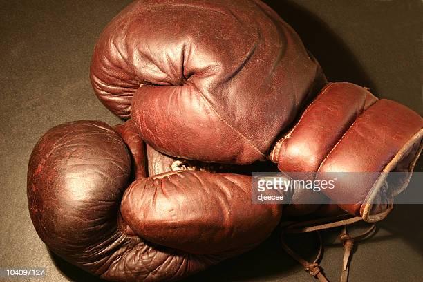 Old boxing gloves under light #1