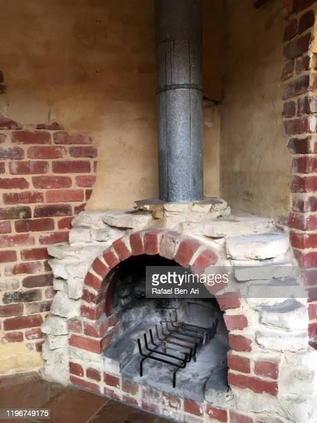old brick fireplace - rafael ben ari stock-fotos und bilder