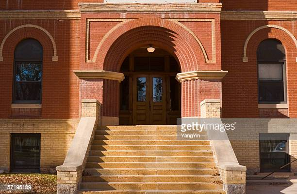 Old Brick School Building Exterior Front Entrance Door and Steps