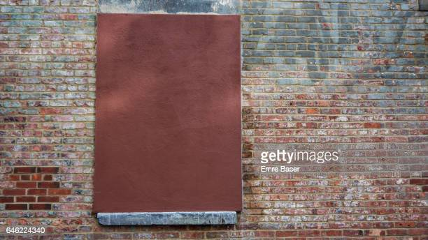 Old Brick Wall with Boarded window