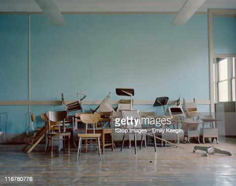 Old Broken Chairs In An Abandoned School Stock Photo