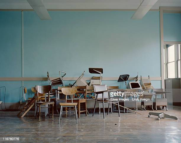 old, broken chairs in an abandoned school - bureau ameublement photos et images de collection