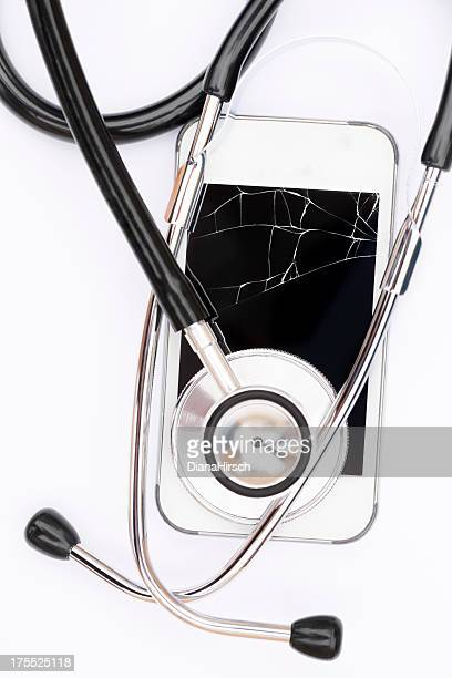 old broken mobile with stethoscope