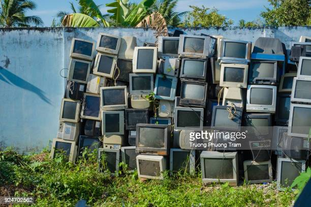 old broken televisions at the scrap yard - obsolete stock pictures, royalty-free photos & images