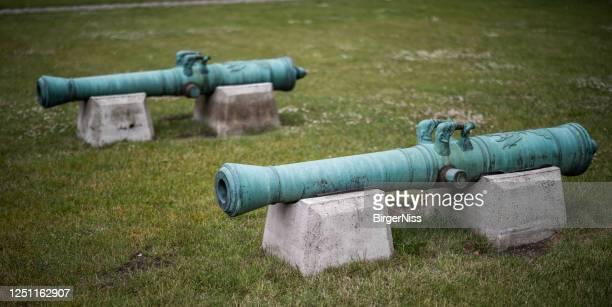 シタデルの古い青銅の大砲、コペンハーゲン、デンマーク - 大砲 ストックフォトと画像