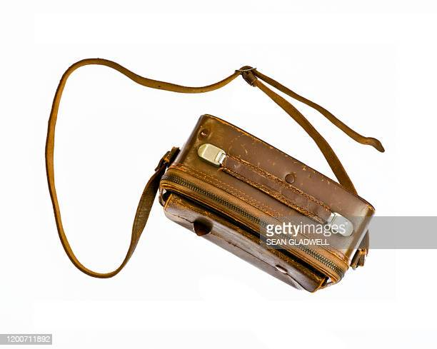 old brown leather camera case - strap stock pictures, royalty-free photos & images
