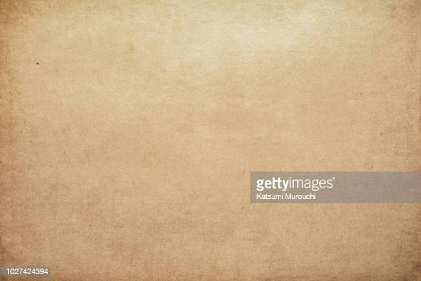 old brown paper texture background - braun stock-fotos und bilder