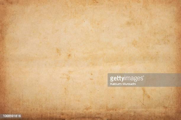 old brown paper texture background - antiguo fotografías e imágenes de stock