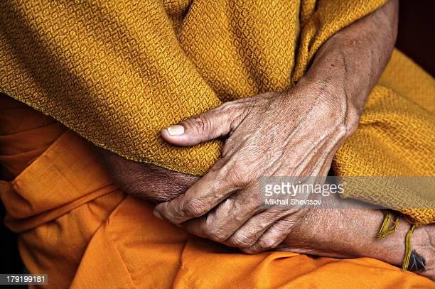 Old Buddhist monk's hands - Wat Phrathat Doi Suthep near Chiang Mai, Thailand