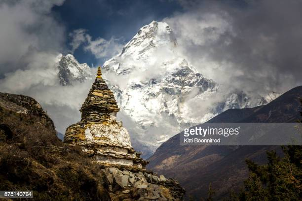 Old buddhist stupa with Mt.Ama Dablam in background on the way to Everest base camp, Nepal
