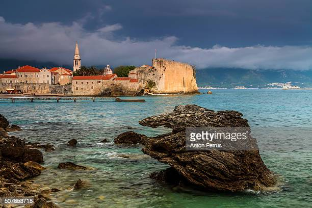 old budva on the background of dramatic sky. montenegro - kotor bay stock pictures, royalty-free photos & images
