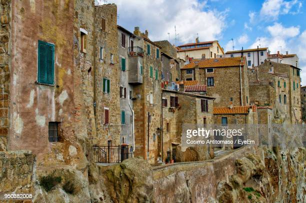 old building against sky - grosseto province stock photos and pictures