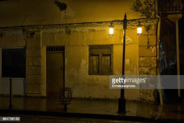 old building and street light under rain at night in batumi. - emreturanphoto stock pictures, royalty-free photos & images