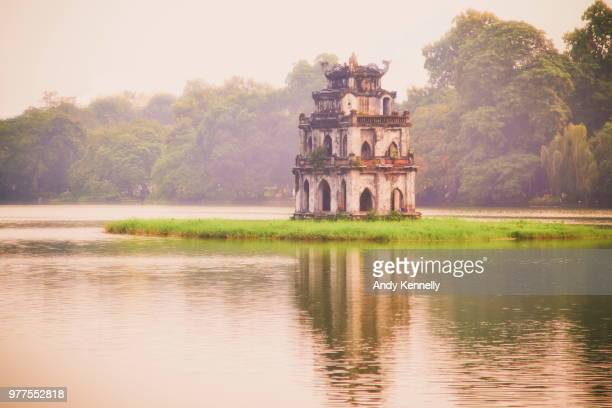 old building in lake, hanoi, hoan kier, vietnam - hanoi stock pictures, royalty-free photos & images