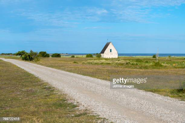 old building on coast - gotland stock pictures, royalty-free photos & images