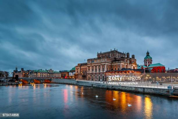 old building on riverbank, stockholm, sweden - stockholm stock pictures, royalty-free photos & images