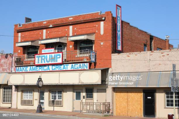 "Old building with banner ""Make America Great Again"""