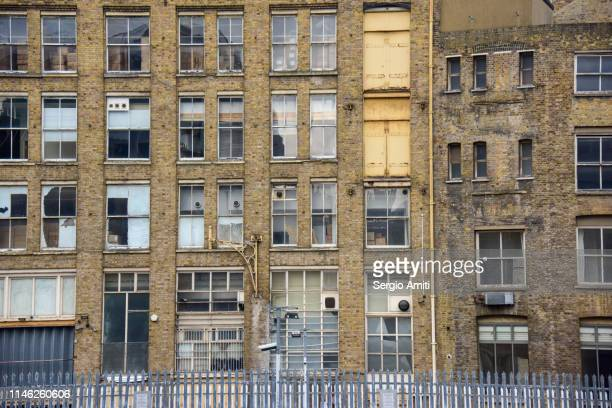 old building with broken windows in london east end - east london stock pictures, royalty-free photos & images