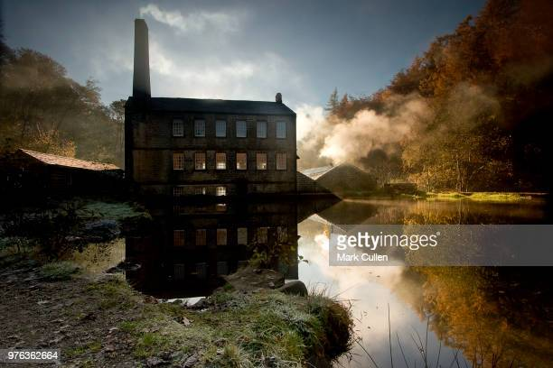 Old building with chimney in background, West Yorkshire, Hardcastle Crags, Gibson Mill, England