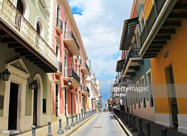 old buildings and blue cobblestones in the streets of old san juan, puerto rico - puerto rico stock pictures, royalty-free photos & images