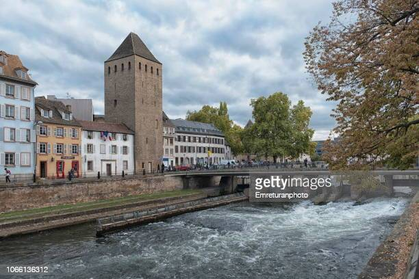 old buildings and tower along faux remparts canal , strasbourg. - emreturanphoto stock pictures, royalty-free photos & images