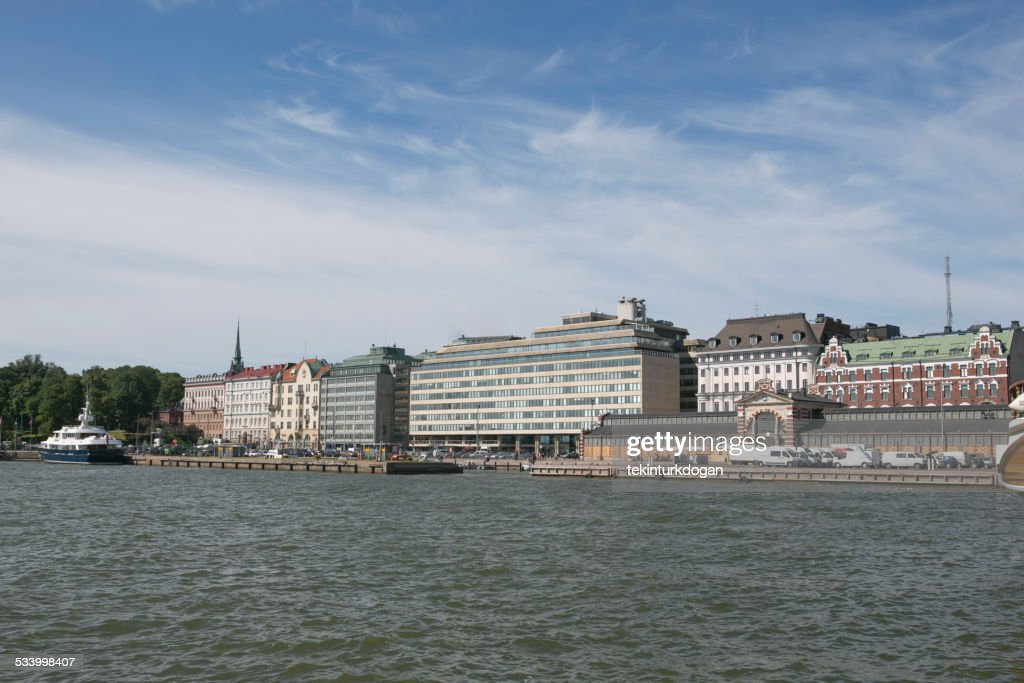 Old buildings are located at port of helsinki finland : Stock Photo