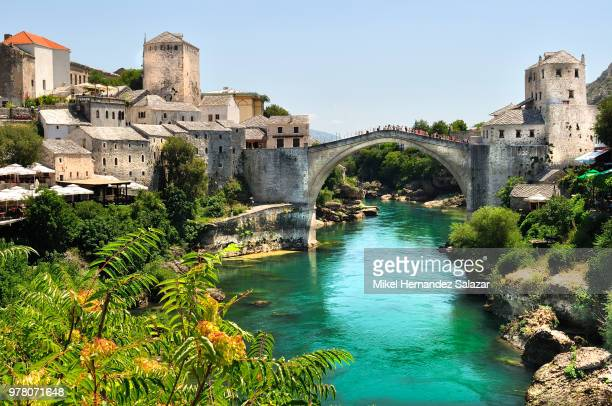 old buildings by the neretva, mostar, bosnia-herzegovina - bosnia and hercegovina stock pictures, royalty-free photos & images