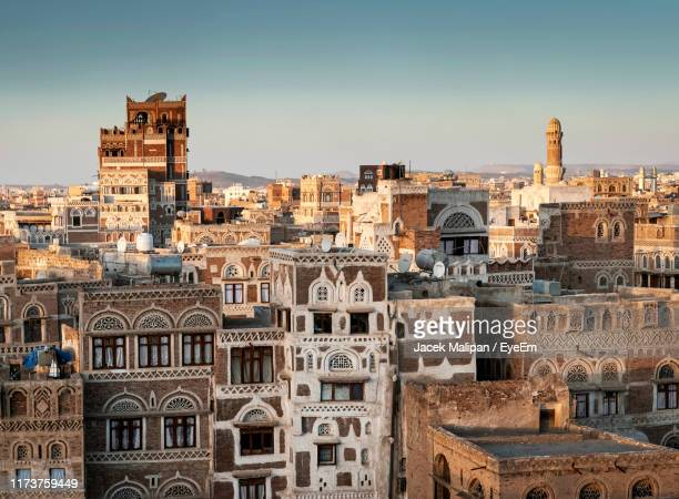 old buildings in city against clear sky - yemen stock pictures, royalty-free photos & images