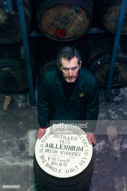 Old Bushmill's Distillery in County Antrim the world's oldest licensed distillery Warehouse employee with a barrel of a special edition Bushmills...