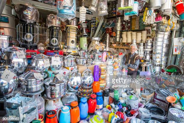 old businessman in his shop in the bazaar, kerman, iran - kerman stock photos and pictures