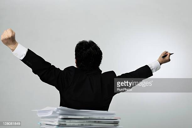 old businessman with arms outstretched
