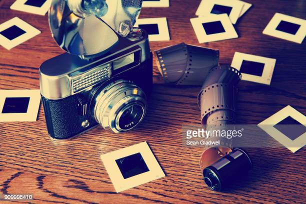old camera and film slides - photographic film camera stock photos and pictures
