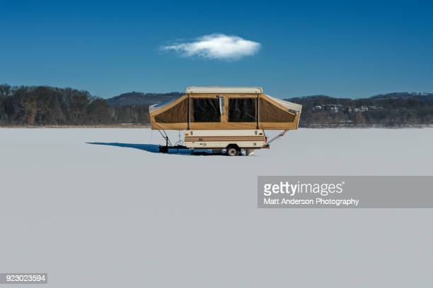Old camper on ice in Winter