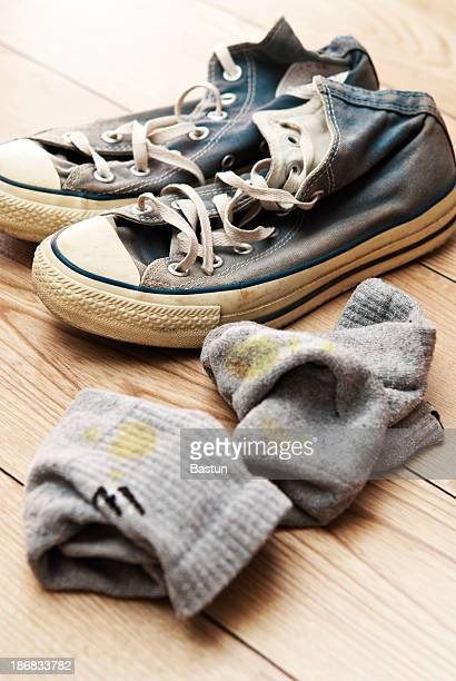 old canvas lace up shoes with dirty socks - unpleasant smell stock pictures, royalty-free photos & images